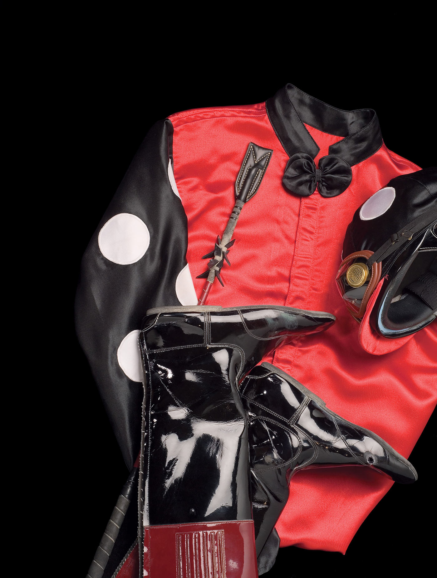 Red black jockey silks and boots